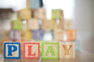 Wooden blocks that spell out PLAY